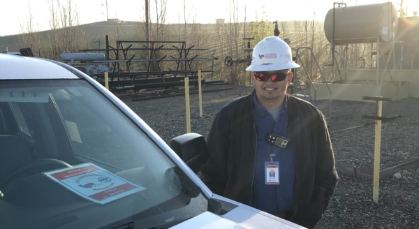 CRC employee standing by his car at a CRC facility.